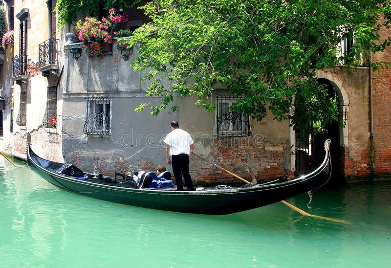 Venice. Gondolier in action on venice canals