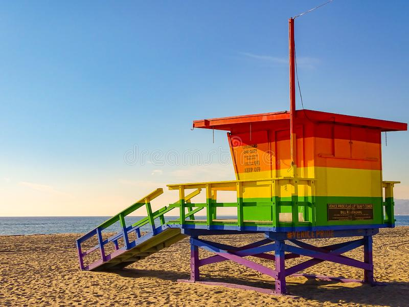 Venice Beach full of pride, rainbow flag lifeguard stations looks out to the blue sea. stock photography