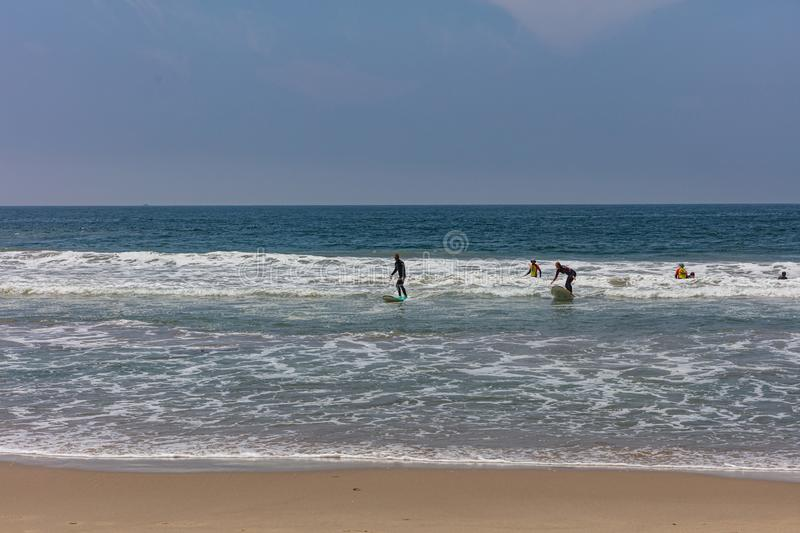 Venice beach, Surfers going to surf, ocean sea waves stock images