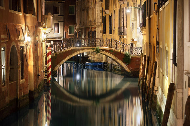 Venice bridge and canal at night stock photography