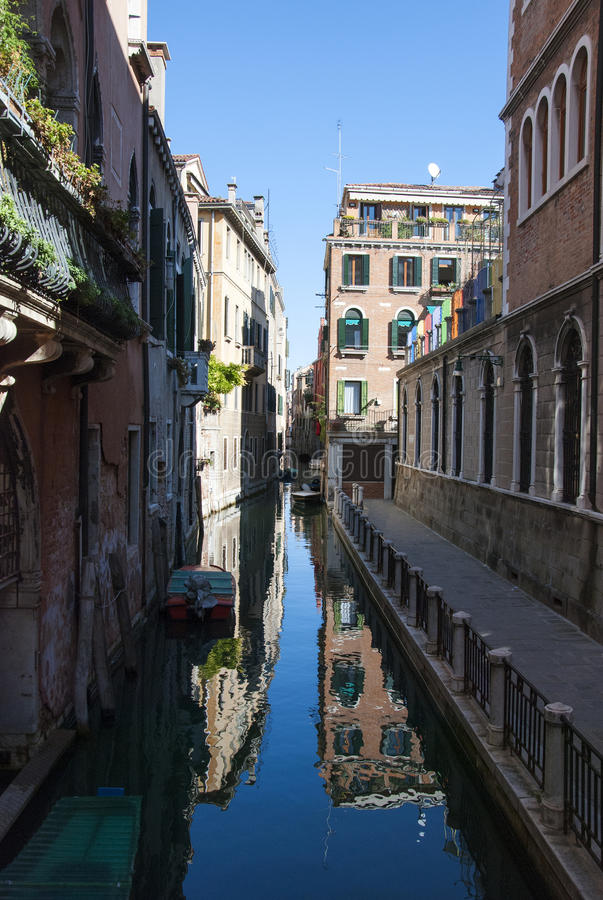 Venice canal. Traditional canal in Venice with reflections - Italy royalty free stock photos