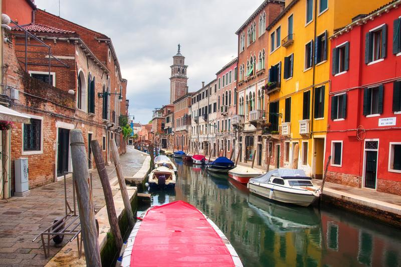 Venice canal cityscape, Italy. Scenic italian exterior in Venezia. Boats on street canal and historical buildings royalty free stock photo