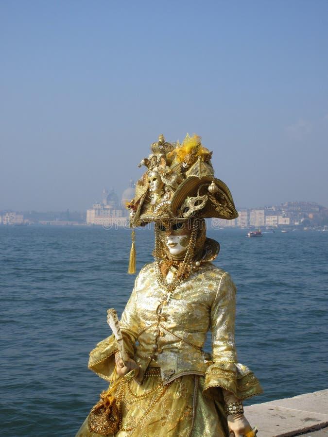 Venice carnival golden lady stock photos