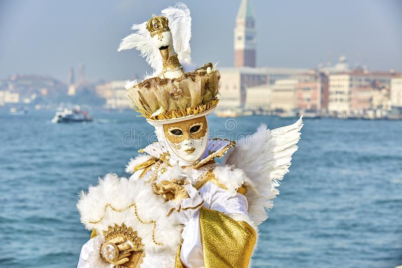 Venice carnival 2017. Venetian Carnival Costume. Venetian Carnival Mask. Venice, Italy. Venetian gold carnival costume. royalty free stock photography