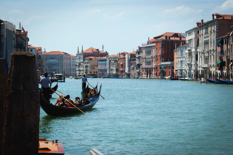 Gondola with passengers floating on the canal Giudecca. Venice. stock image