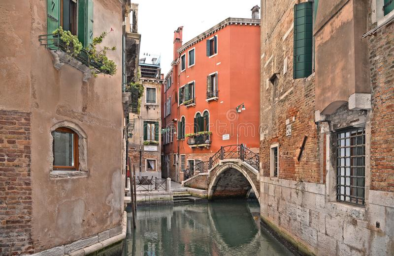 Venice colorful corner with old buildings, small water canal, little bridge and boats. Venice colorful corner with old buildings and architecture, small water royalty free stock images
