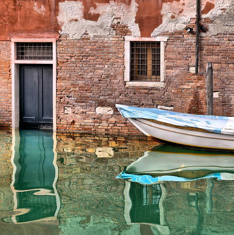 Venice colorful corners with old buildings, window, door and architecture, boats and beautiful water reflections on small canal,. Italy stock images