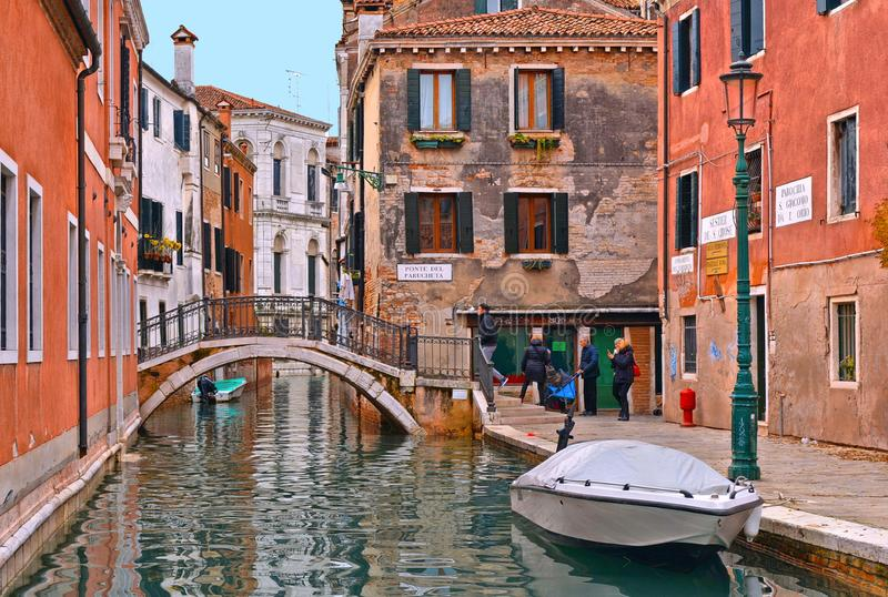 Venice colorful corners, old buildings and windows, people, water canal with reflections, boats and small bridge , Ita. 17.11.2016.Venice colorful corners, old royalty free stock images