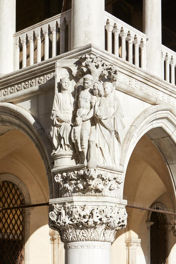 Venice, Doge palace white sculptures and capital in Italy. Venice, Doge palace white sculptures and capital in a sunny day in Italy stock photo
