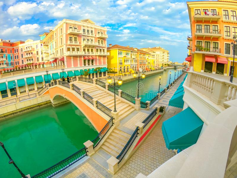 Venice Doha sunset. Wide angle view of panoramic bridge in Venice at Qanat Quartier in the Pearl, Persian Gulf, Middle East at sunset. Aerial view picturesque stock images