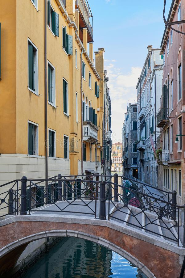 Venice, empty bridge and canal in a summer day in Italy stock image