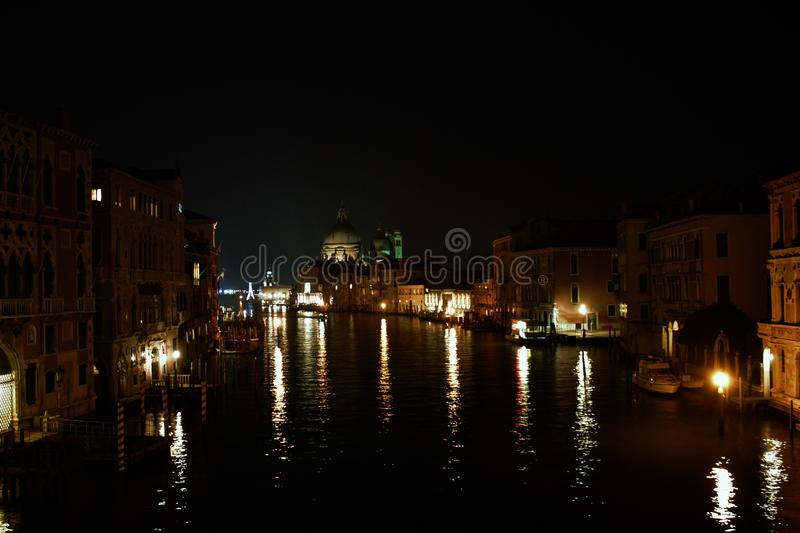 Venice in the evening, the romantic city is enriched with lights that make another image, a walk is a must. Venice in the evening, the romantic city is enriched royalty free stock photos