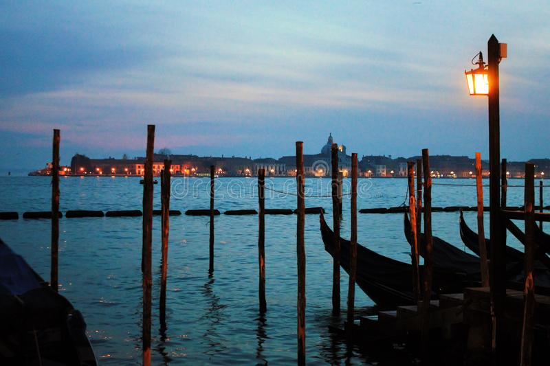 Venice in the evening, the romantic city is enriched with lights that make another image, a walk is a must. Venice in the evening, the romantic city is enriched royalty free stock photography