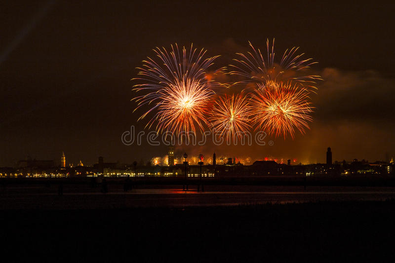 Venice fireworks. Redentore's day is very famous in Venice for his fireworks. This is a different point of view, in front of the lagoon and with the city in royalty free stock photography