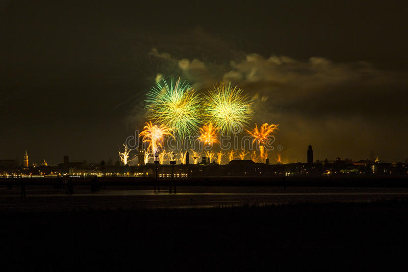 Venice fireworks. Redentore's day is very famous in Venice for his fireworks. This is a different point of view, in front of the lagoon and with the city in royalty free stock photos