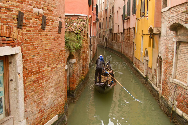 Venice gondola on small canal stock photo