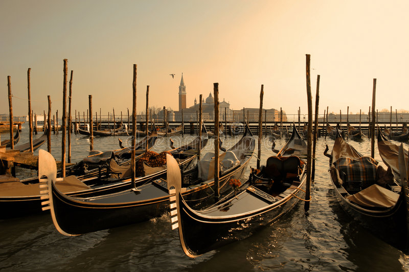 VENICE GONDOLAS. Gondolas on the canal in Venice. Italy. Brown colors stock images