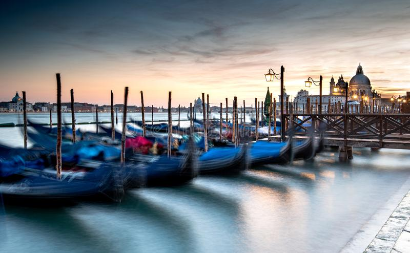 Venice Gondolas moored at the San Marco square. Or Piazza san Marco,  and the San Giorgio Maggiore island at the back royalty free stock image