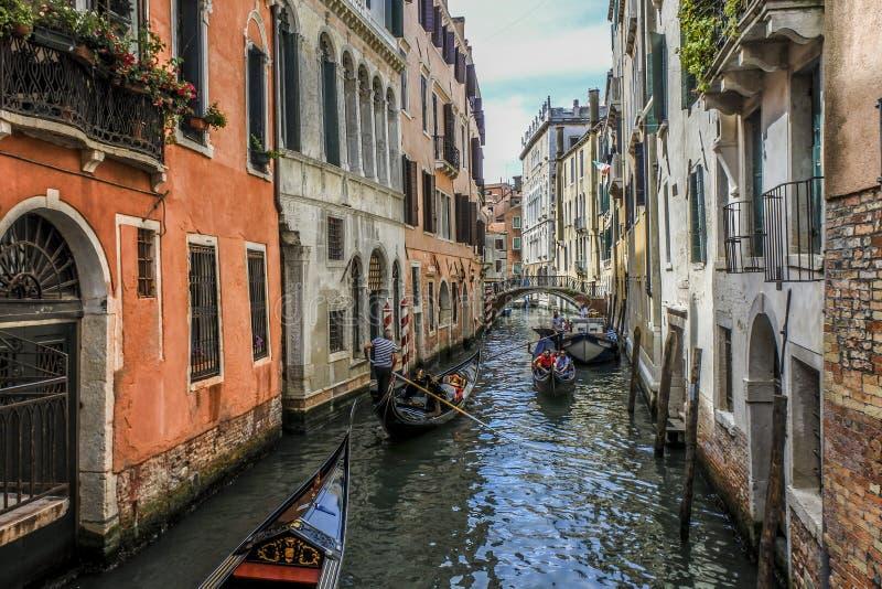 Venice gondolas in narrow alley stock photo
