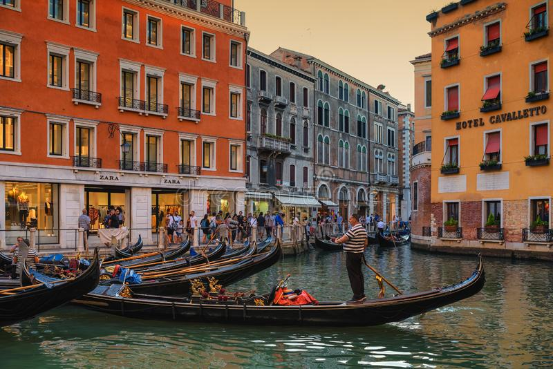 Venice, gondolas on narrow canals at sunset, popular tourist attraction royalty free stock photography