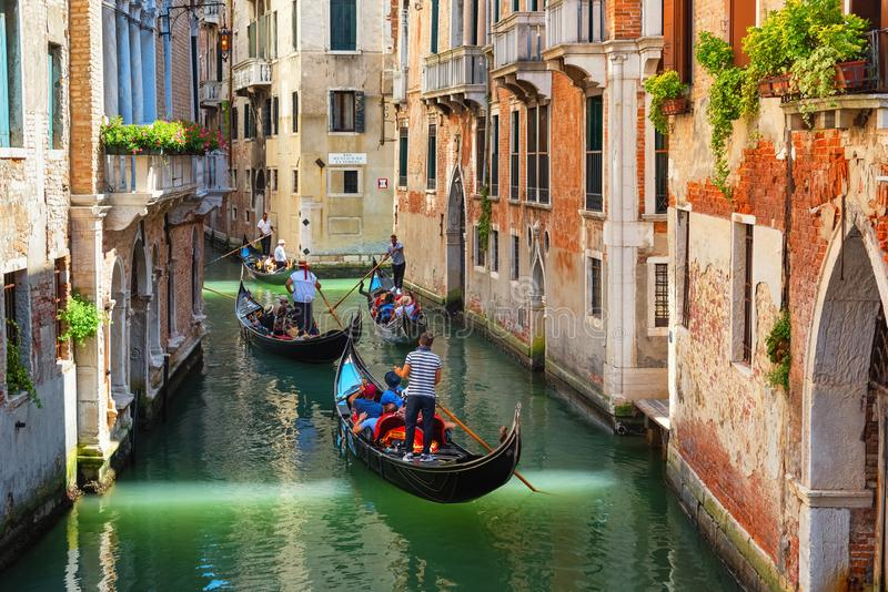 Venice, gondolas sailing along narrow canals, popular tourist attraction royalty free stock images