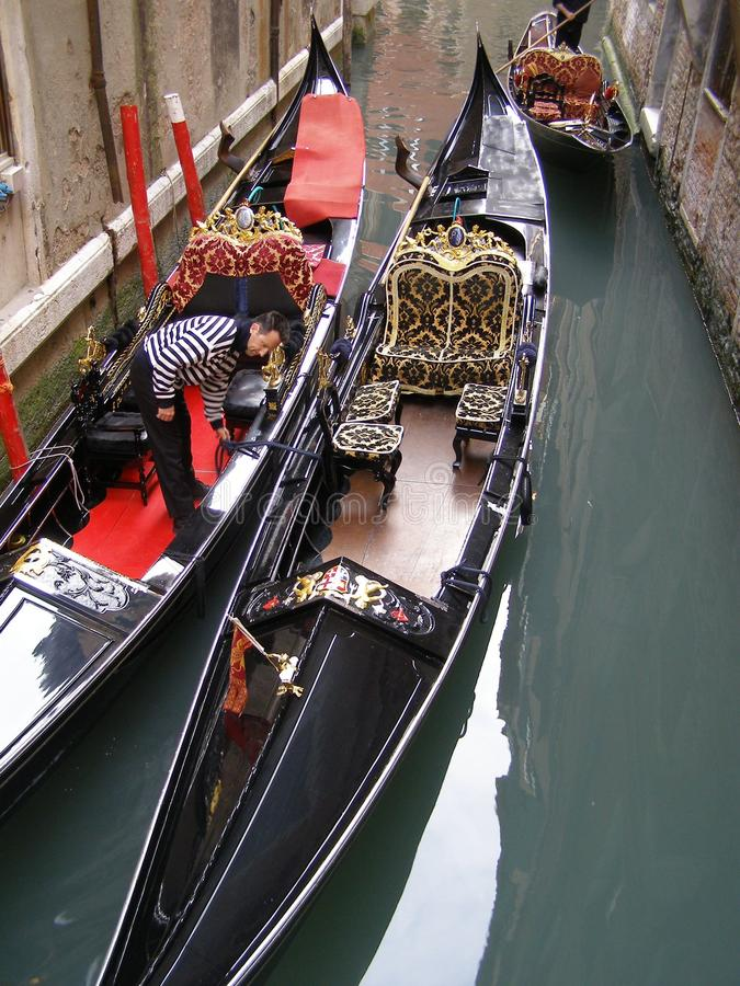 Venice gondolas with staff member royalty free stock photo
