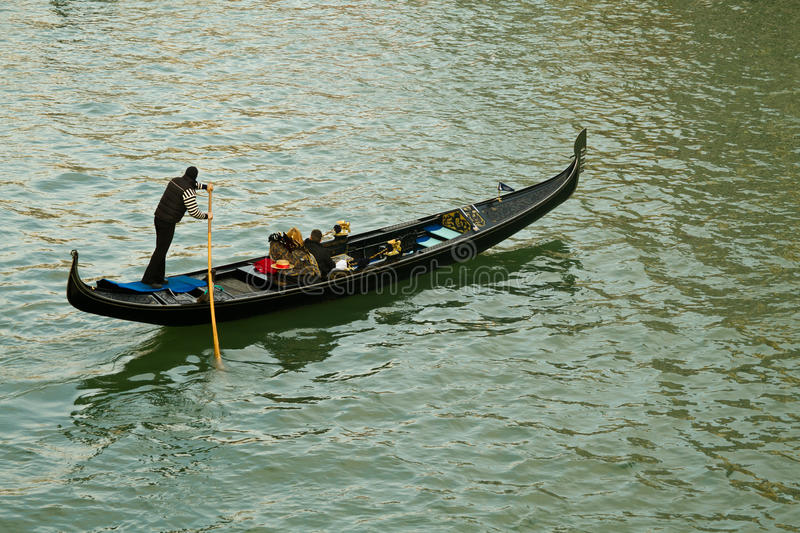 Venice gondolier on canal stock photography