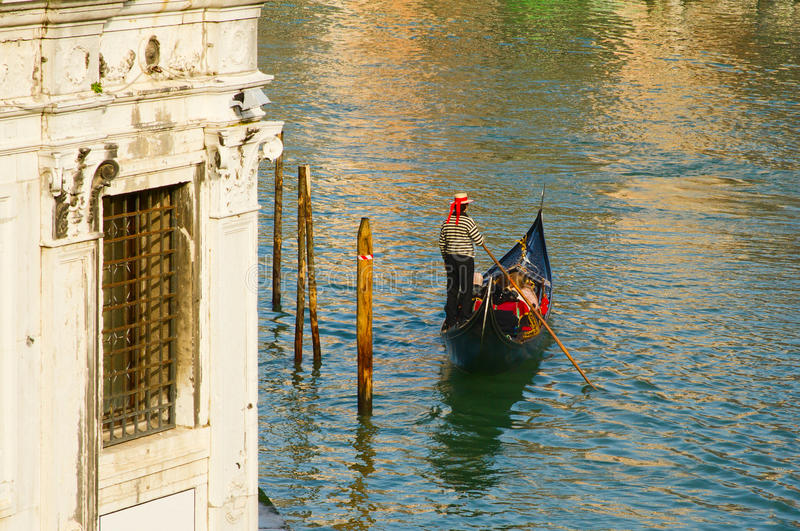 Venice gondolier on canal royalty free stock photo
