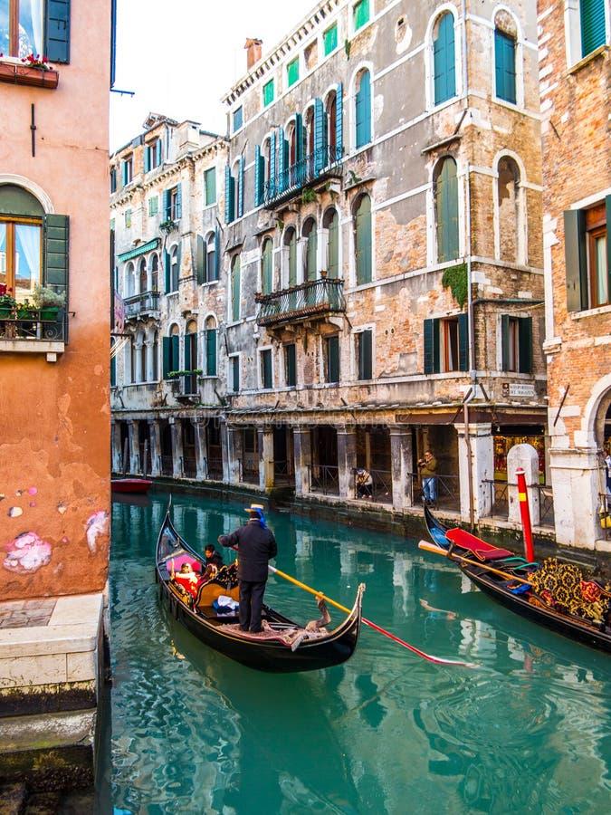 Venice gondolier driving gondola stock photos