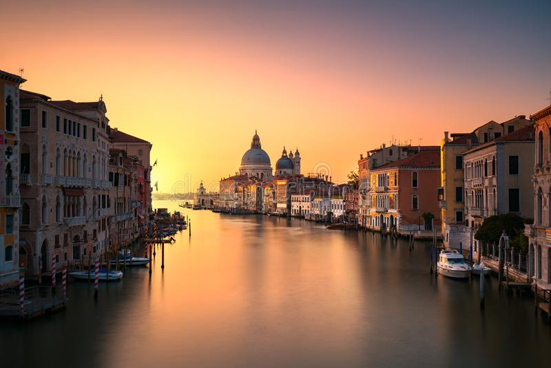 Venice grand canal, Santa Maria della Salute church landmark at. Venice grand canal view, Santa Maria della Salute church landmark at sunrise. Italy, Europe stock photos