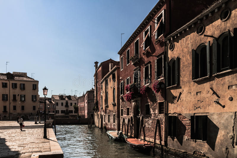 Venice Inner City. VENICE, ITALY - SEPTEMBER 06 2013: Scene from the Canals of Venice. Boats on the water. Old Architecture. Sunny Blue Sky royalty free stock photos
