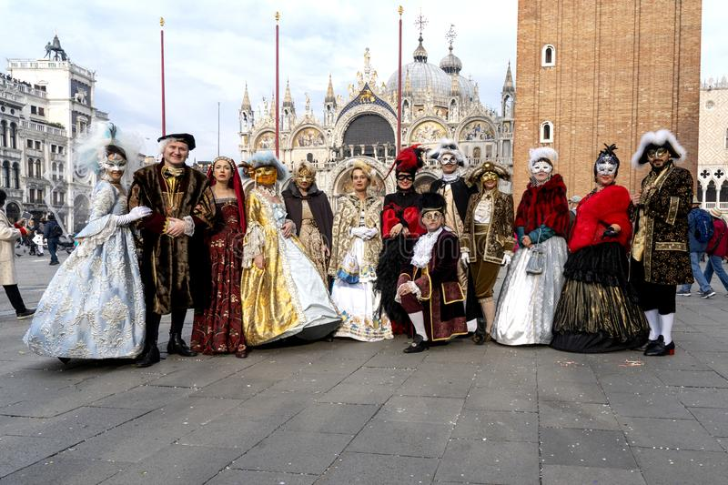 Venice, Italy: February 26, 2019 : Carnival mask. People in masks and costumes on Venetian carnival. Colorful carnival masks at a stock photos