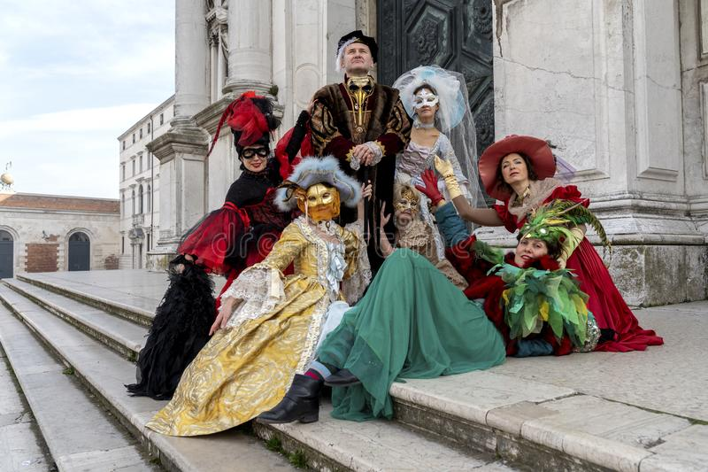 Venice, Italy: February 26, 2019 : Carnival mask. People in masks and costumes on Venetian carnival. Colorful carnival masks at a royalty free stock photography