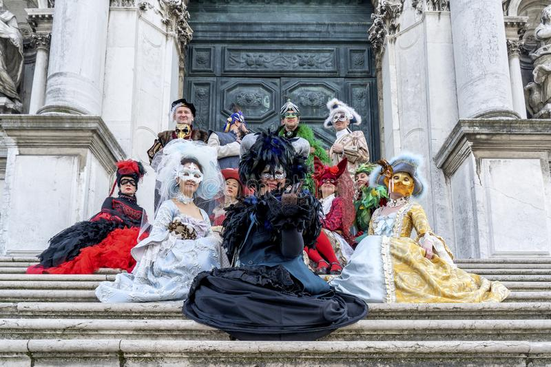 Venice, Itali: February 26, 2019 : Carnival mask. People in masks and costumes on Venetian carnival. Colorful carnival masks at a stock images