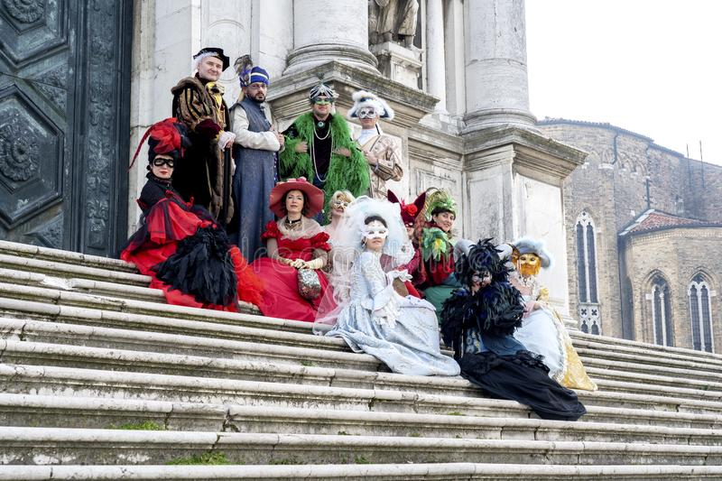 Venice, Italy: February 26, 2019 : Carnival mask. People in masks and costumes on Venetian carnival. Colorful carnival masks at a royalty free stock photos