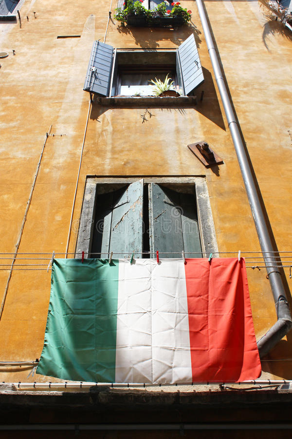 Venice, Italy. Italian flag hanging out in the city of Venice, Italy royalty free stock photo