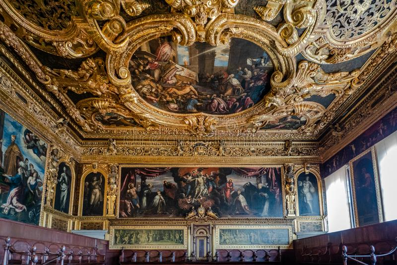 Venice, Italy - April 18 2019 The Senat Chamber at the Doge Palace with tourist royalty free stock photo