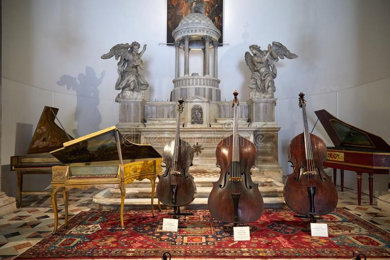 Ancient Italian string instruments exhibition in San Maurizio church in Venice, Italy stock photo