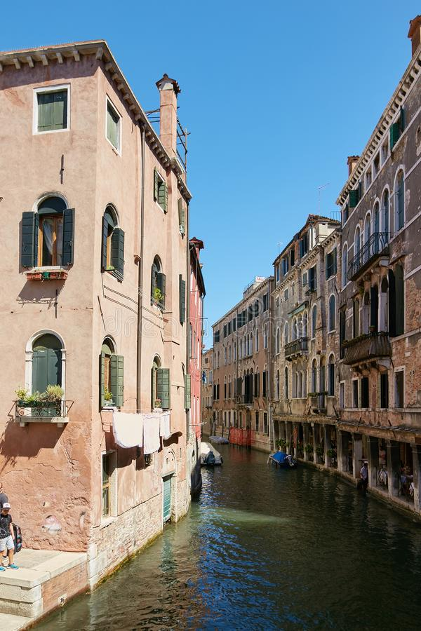 Venice, Italy - August 14, 2017: Venice canal with boats and classic buildings. royalty free stock photo
