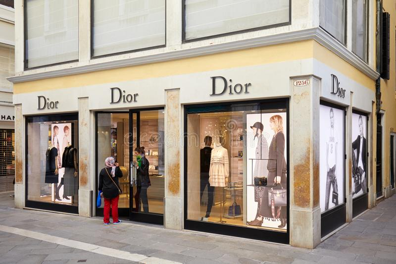 Dior store with large windows and people in Venice, Italy stock photos
