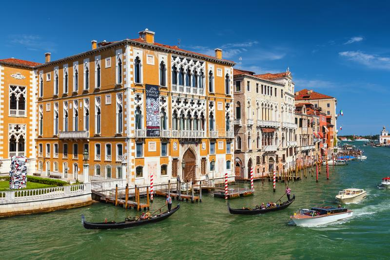 Venice, Palazzo Cavalli-Franchetti and Grand canal with gondolas and boats, historic buildings, popular tourist attraction royalty free stock photography