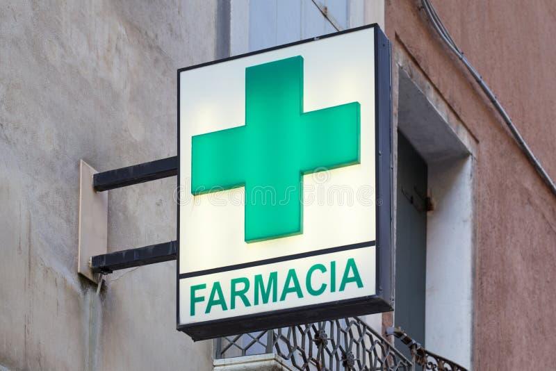 Pharmacy, farmacia sign with green cross in Italy royalty free stock image