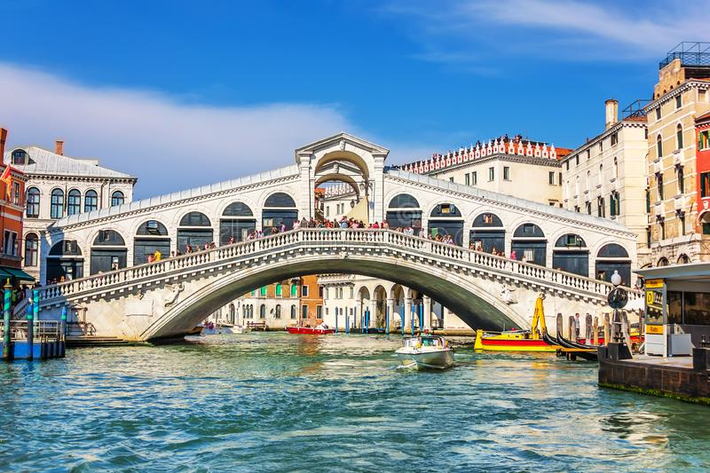 Venice,Italy - August 22, 2018: The Rialto Bridge and many tourists on a summer day royalty free stock photography