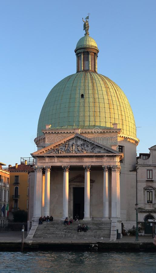 Venice, Italy. The Church of San Simeon Piccolo on the Grand Canal embankment on sunset stock image