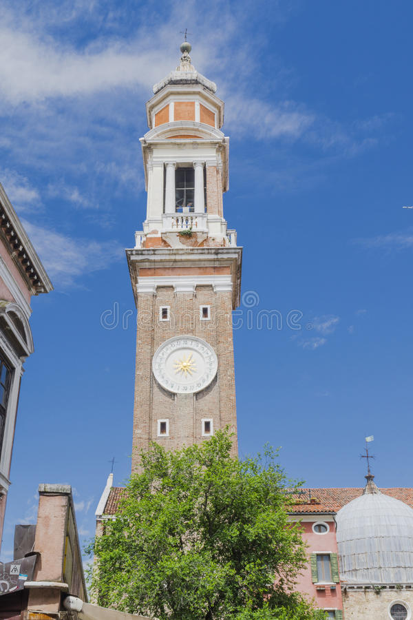 Venice in Italy. Europe . Old church and tower with the clock royalty free stock images