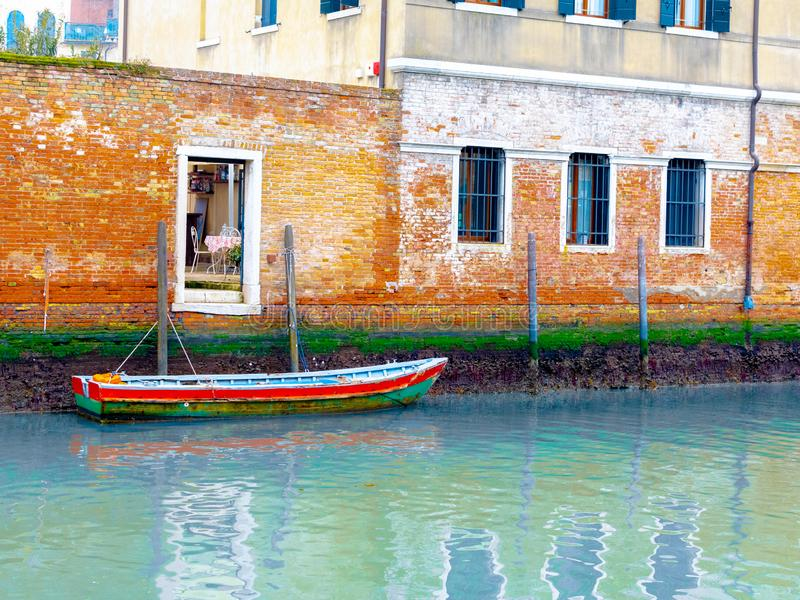 Boat in the Canals of the City,parked in fron of owner`s house. Venice / Italy 19 february 2019 :boat in the Canals of the City,parked in fron of owner`s house stock photography