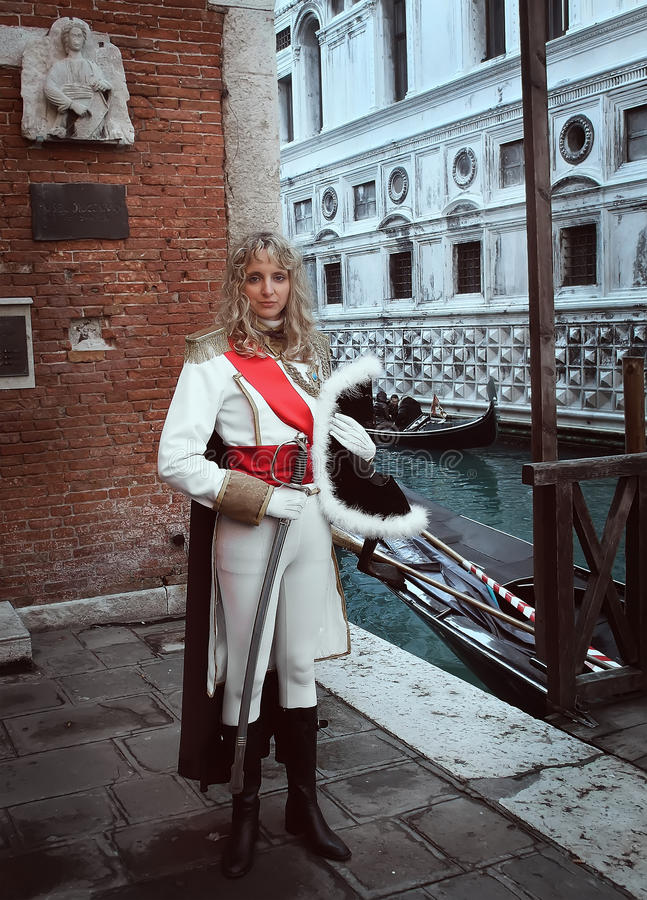 A beautiful musketeer woman at Venice Carnival royalty free stock photography