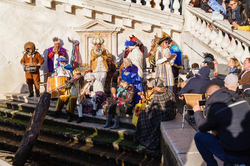 VENICE, ITALY – FEBRUARY 17, 2019: People in carnival costumes on Piazza San Marco in Venice during the carnival royalty free stock photo