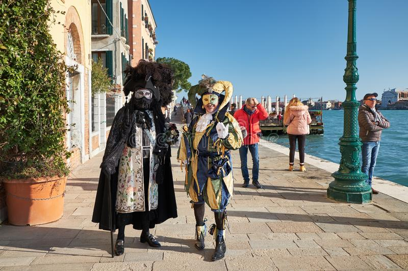 Venice, Italy - February 10, 2018: People in masks and costumes at the Venice Carnival stock image