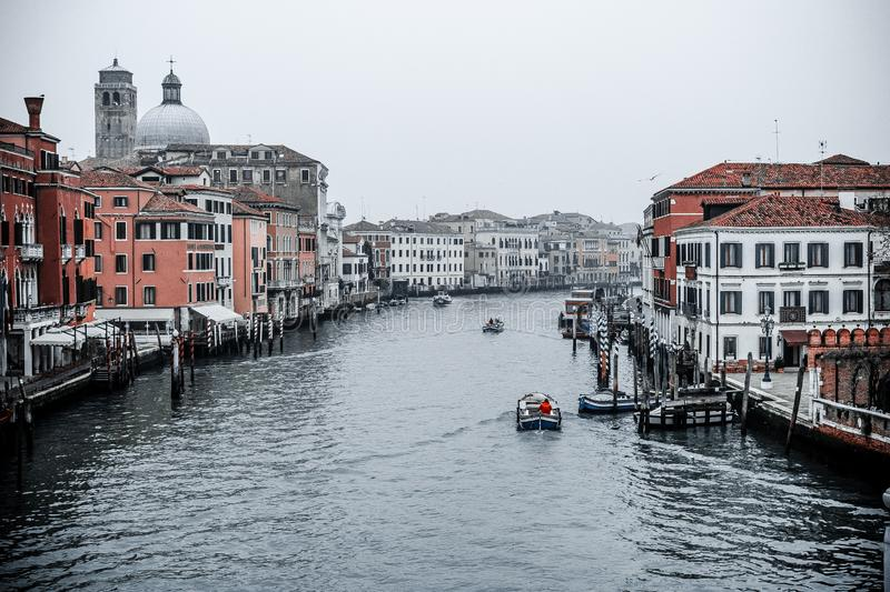 Snapshot of the  canal and the buildings around it,also boats and other transport,photo taken from the bridge next to central stat. Venice / Italy 19 february stock photo